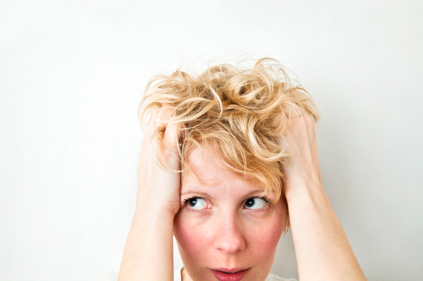Photo of woman tugging her hair